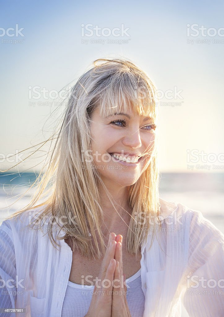 Happy woman at the beach stock photo