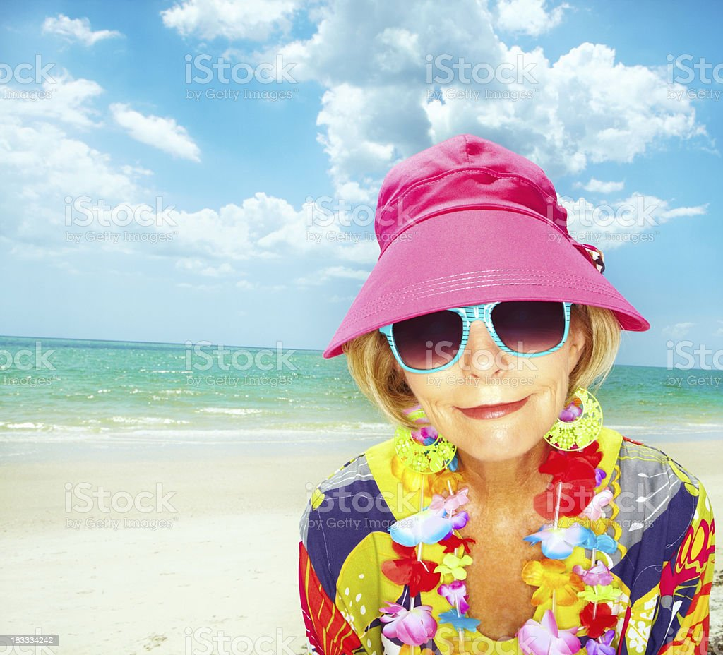 Happy woman at the beach smiling royalty-free stock photo