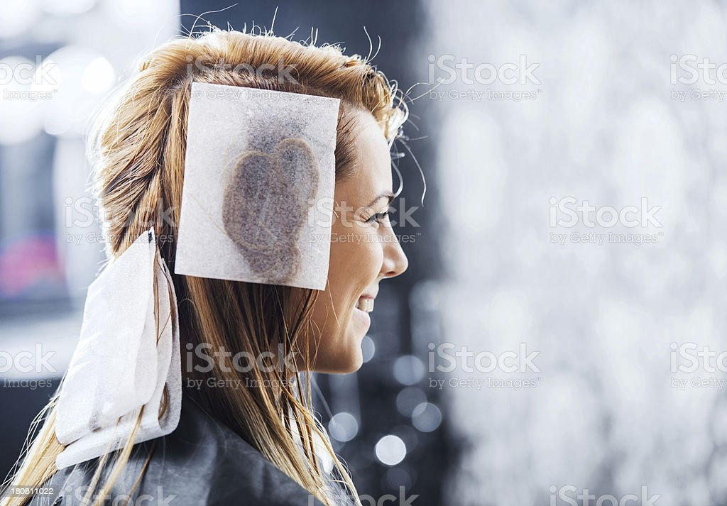 Happy woman at the hairdresser's. stock photo