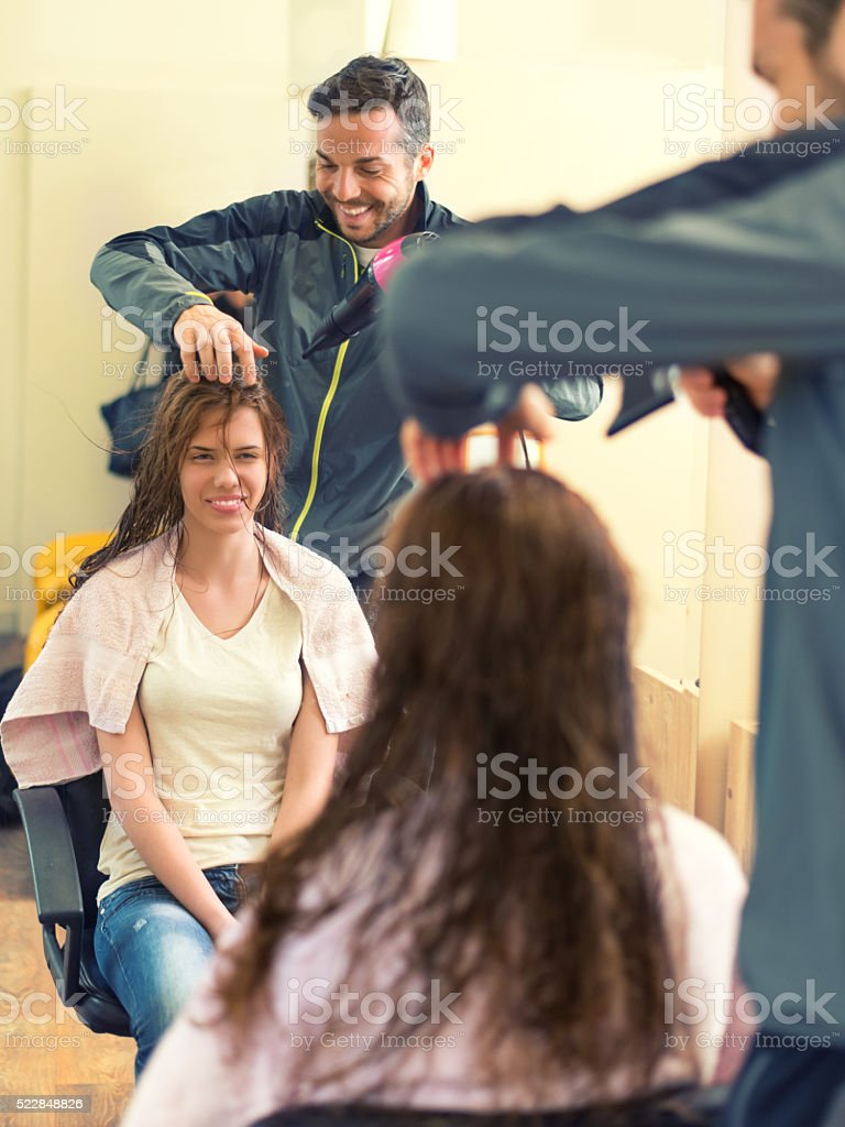 Happy woman at the hairdresser's stock photo