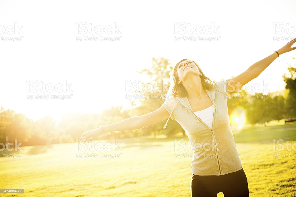 Happy woman at the park royalty-free stock photo