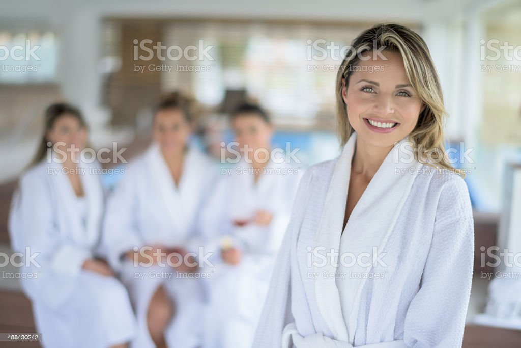 Happy woman at the spa with a group of friends stock photo