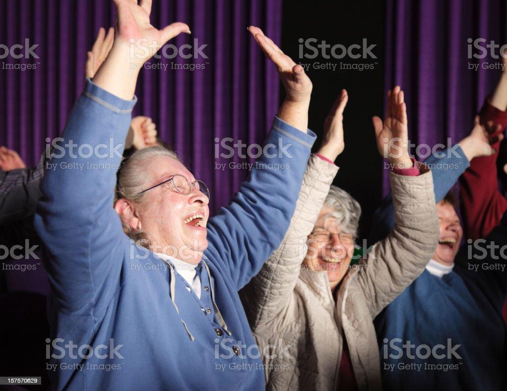 Happy Woman Audience Member stock photo