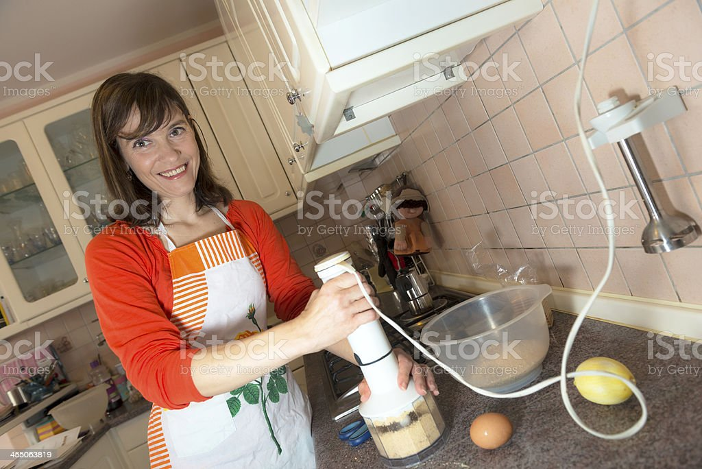 Happy Woman Baking in Domestic Kitchen royalty-free stock photo