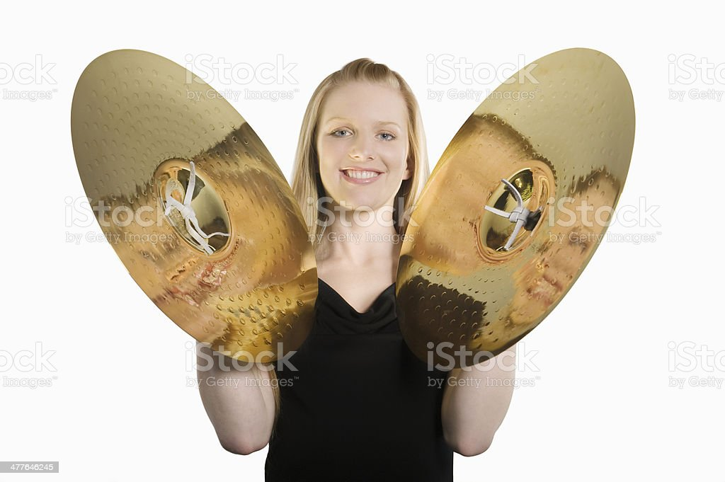 Happy Woman Banging Cymbal stock photo