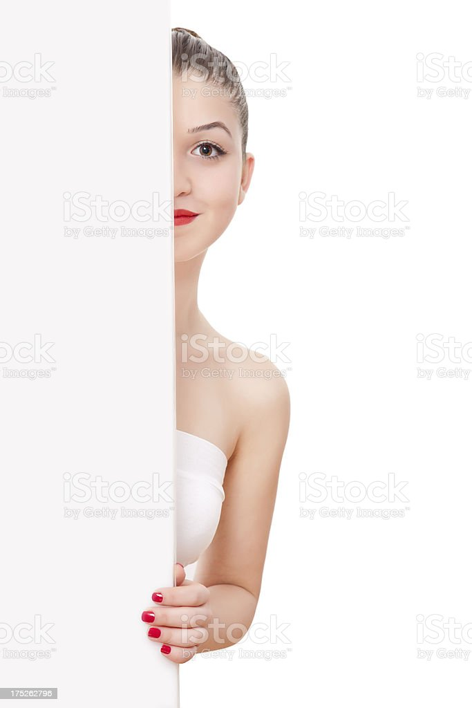 Happy woman behind a placard- Copyspace royalty-free stock photo