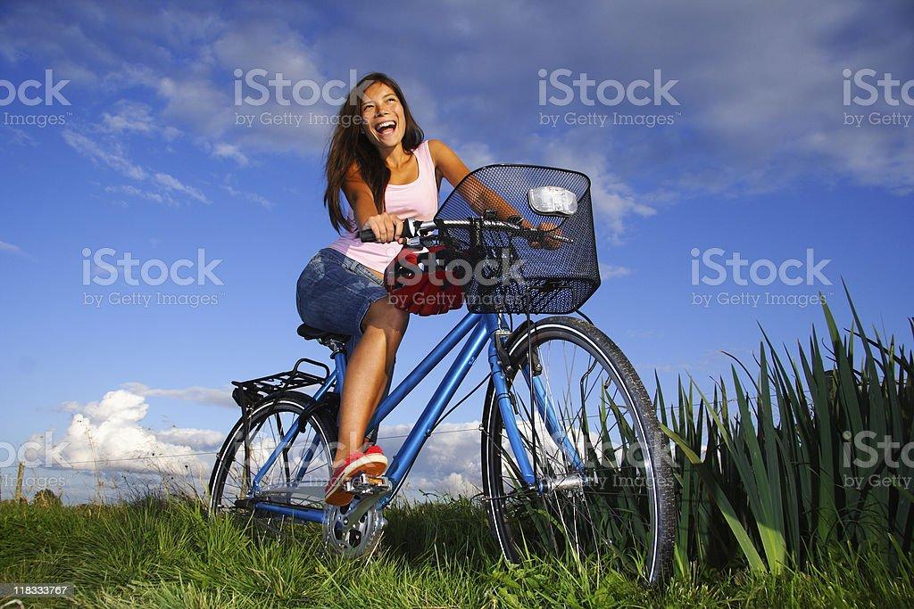 Happy woman biking stock photo