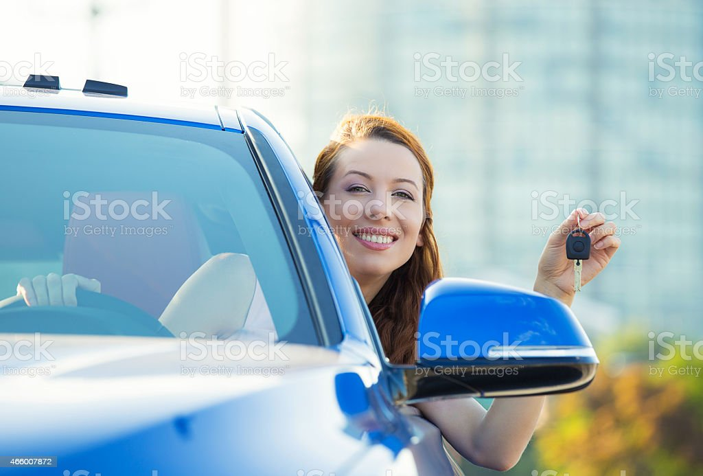 Happy woman, buyer sitting in her new blue car stock photo
