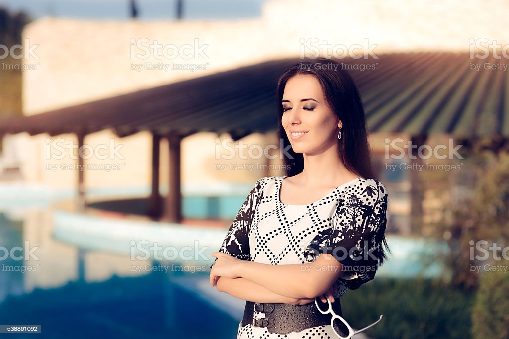 Happy Woman by the Pool Enjoying Summer Holiday stock photo