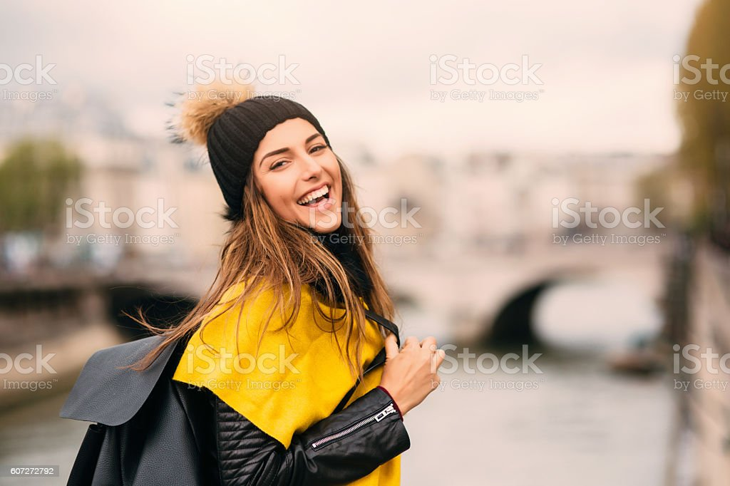 Happy woman by the river stock photo