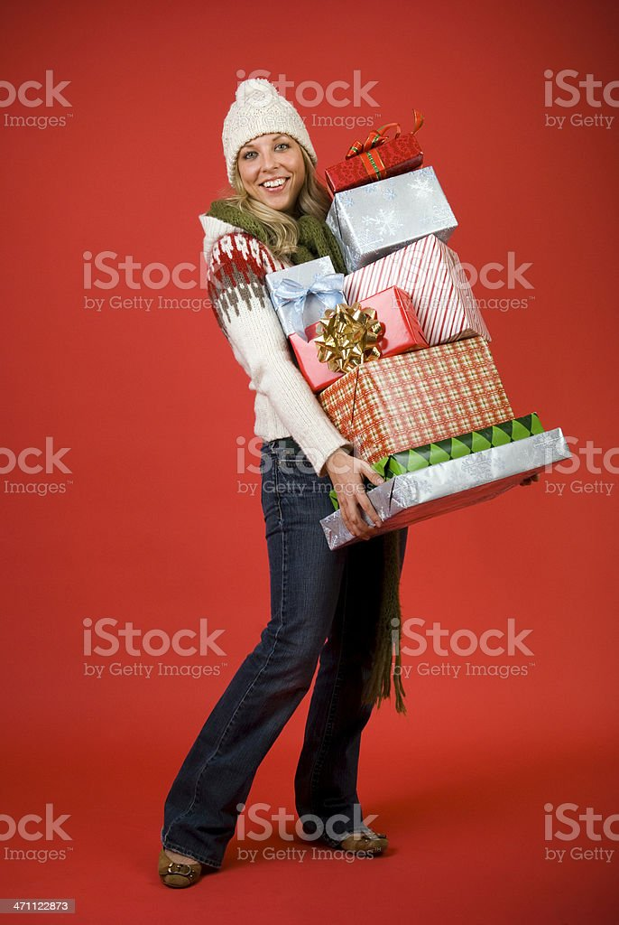 Happy Woman Carrying Many Christmas Gifts royalty-free stock photo