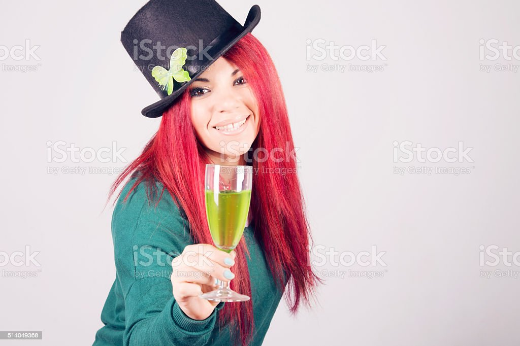 Happy woman celebrating Saint Patrick's day on march 17th stock photo