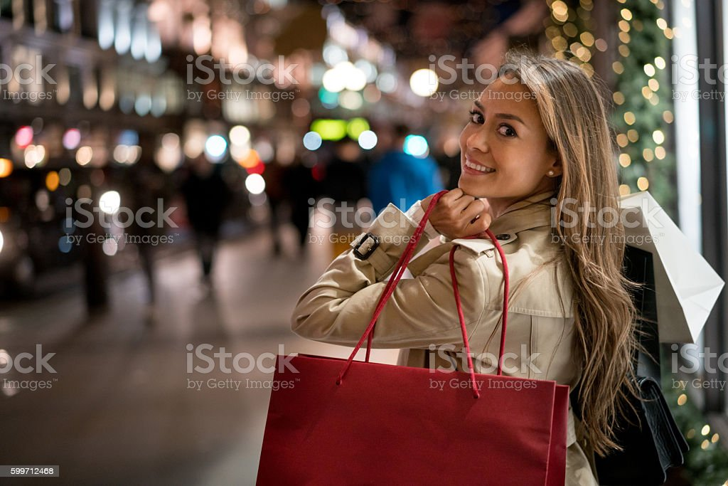 Happy woman Christmas shopping stock photo