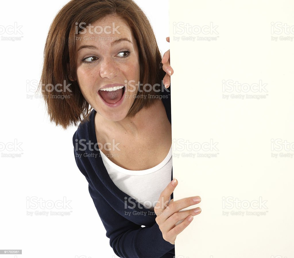 Happy woman coming around a corner royalty-free stock photo