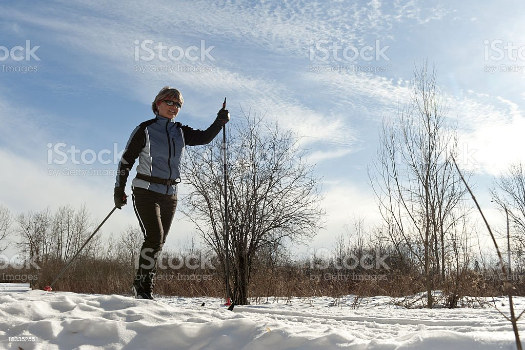 Happy woman, cross-country skiing, winter sport royalty-free stock photo