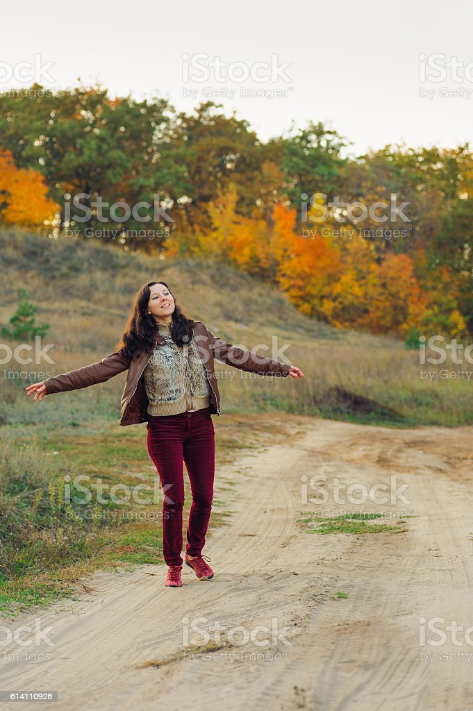 happy woman dance on forest road stock photo