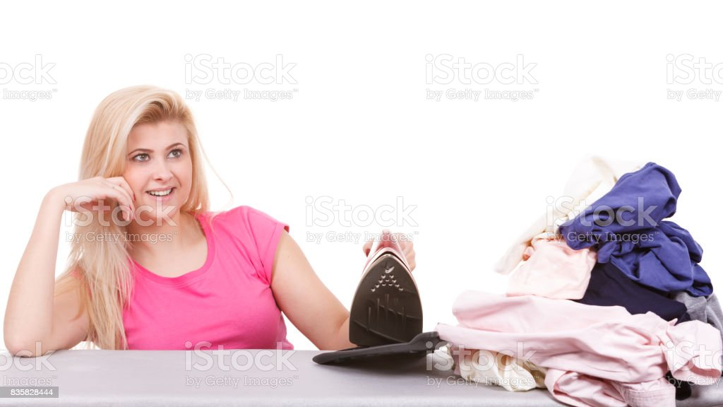 Happy woman doing ironing stock photo