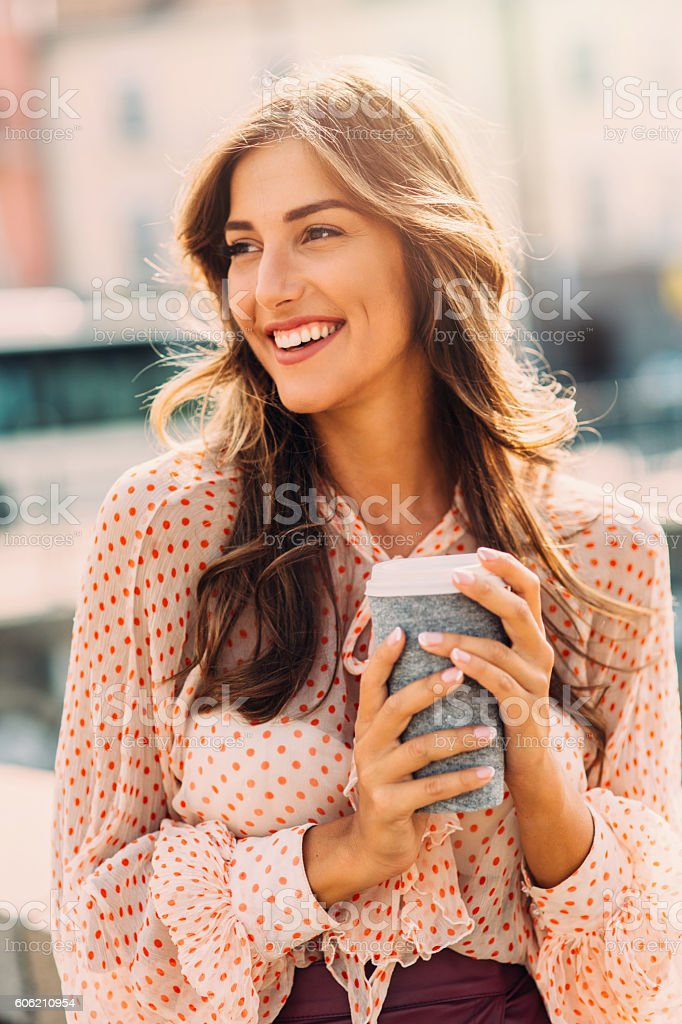 Happy woman drinking coffee stock photo