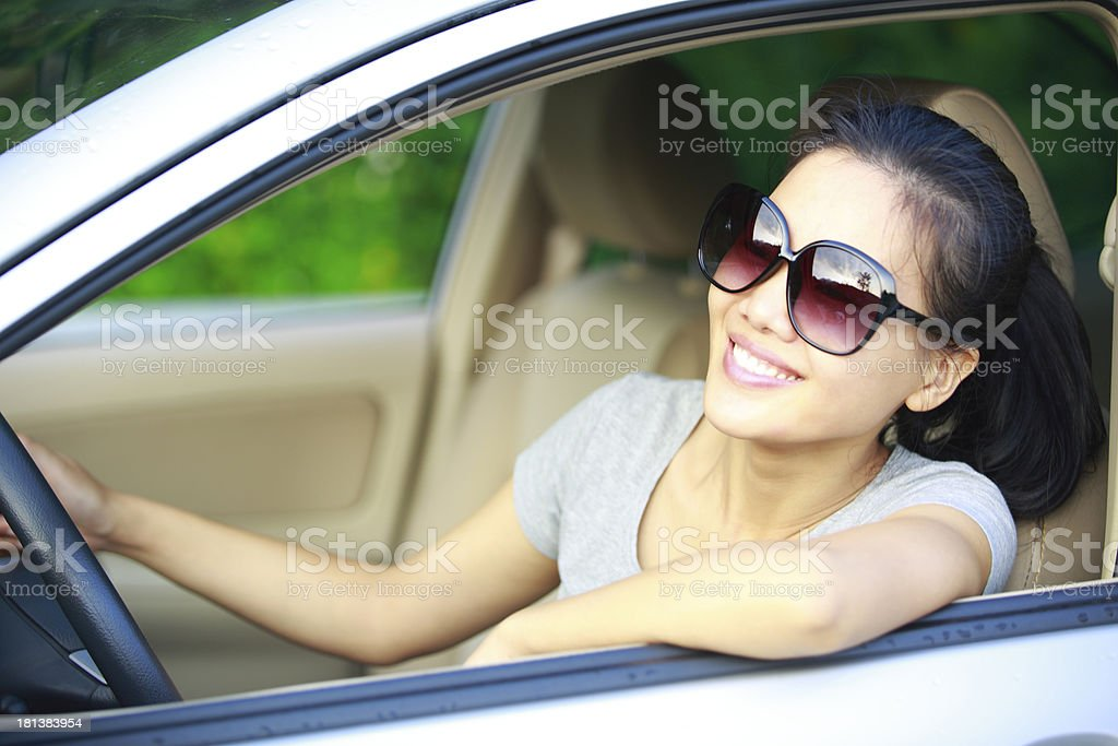 happy woman driver driving a car royalty-free stock photo