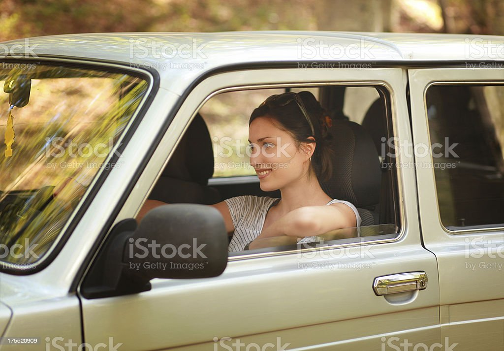 Happy woman driver in a car stock photo