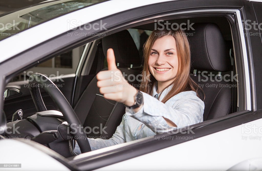 happy woman driver in her new car royalty-free stock photo