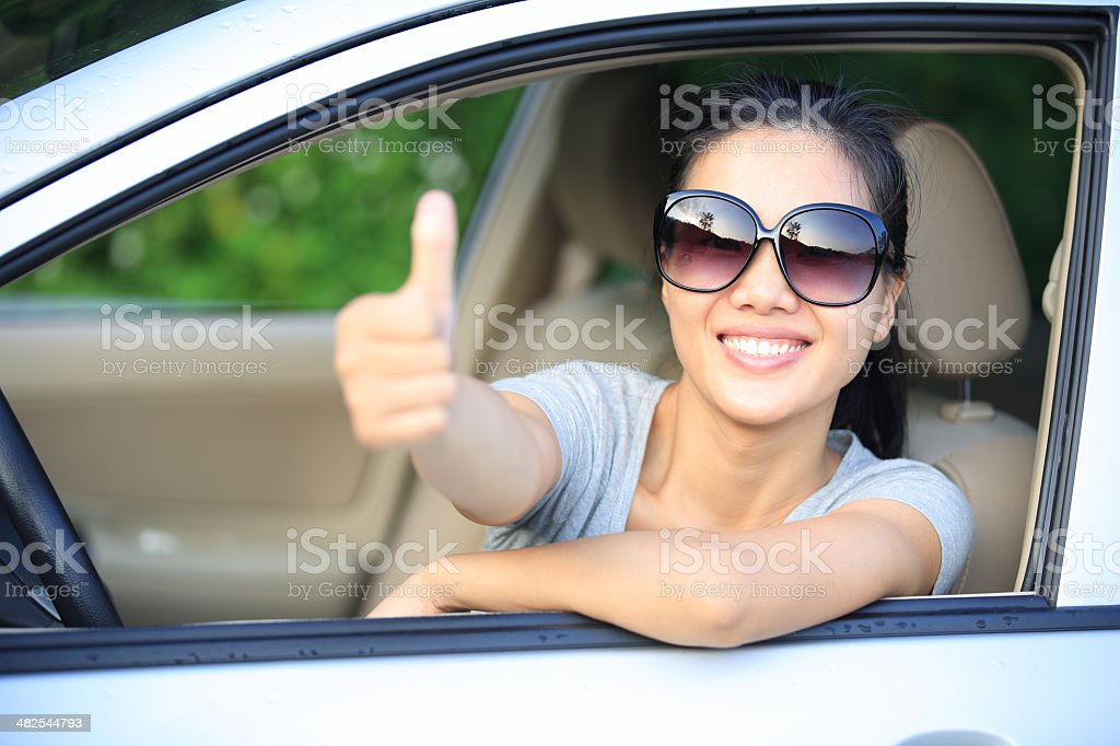 happy woman driver thumb up stock photo