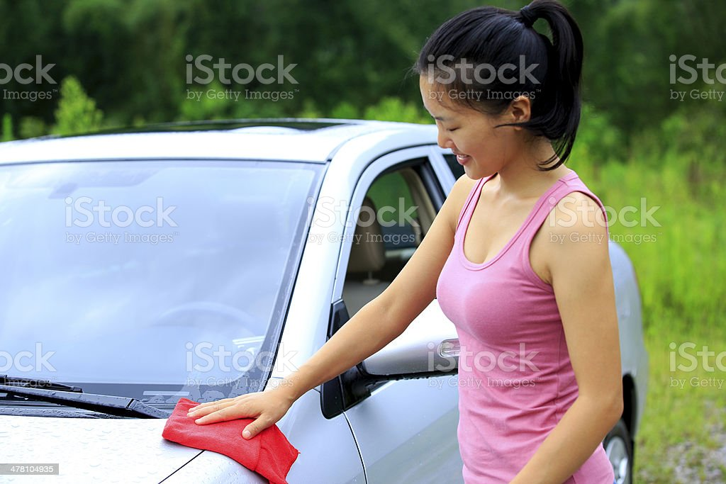 happy woman driver wash her car royalty-free stock photo