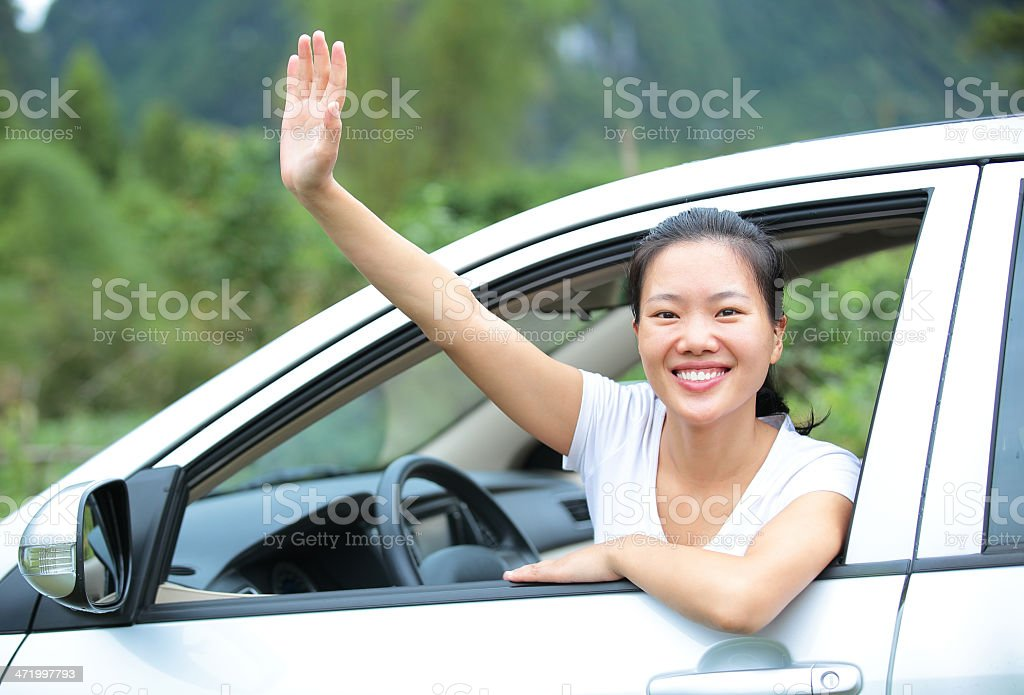 happy woman driver wave hand give salute gesture stock photo