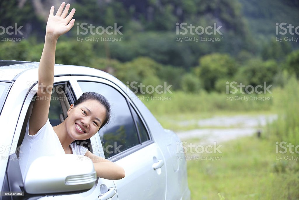happy woman driver wave hand royalty-free stock photo