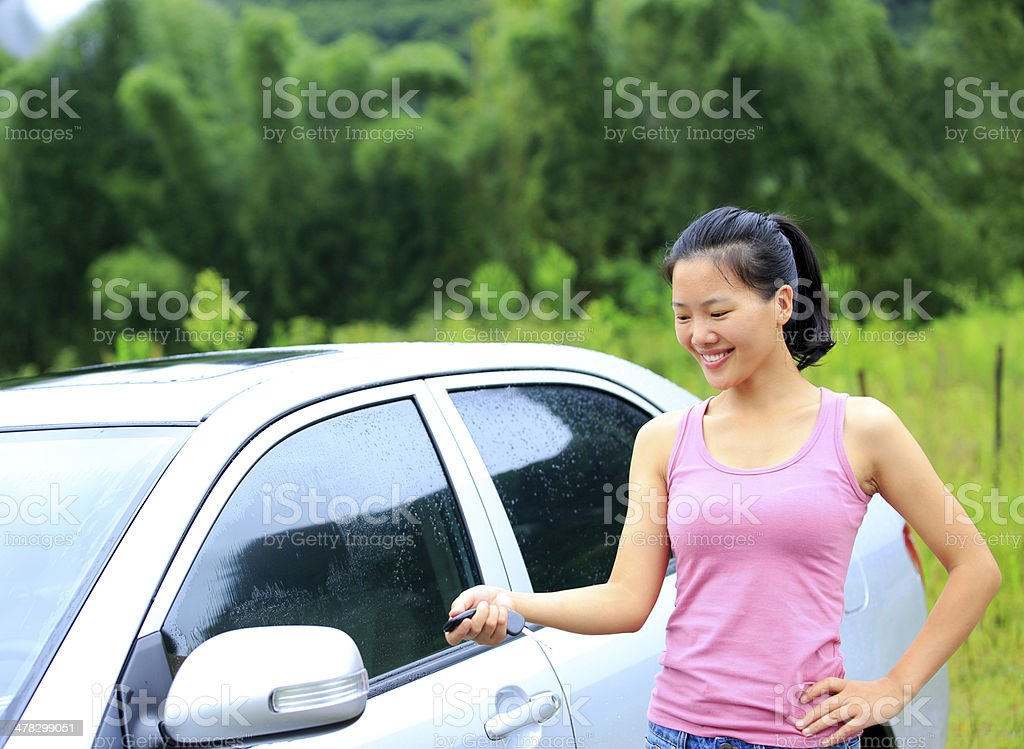 happy woman driver with her first car royalty-free stock photo