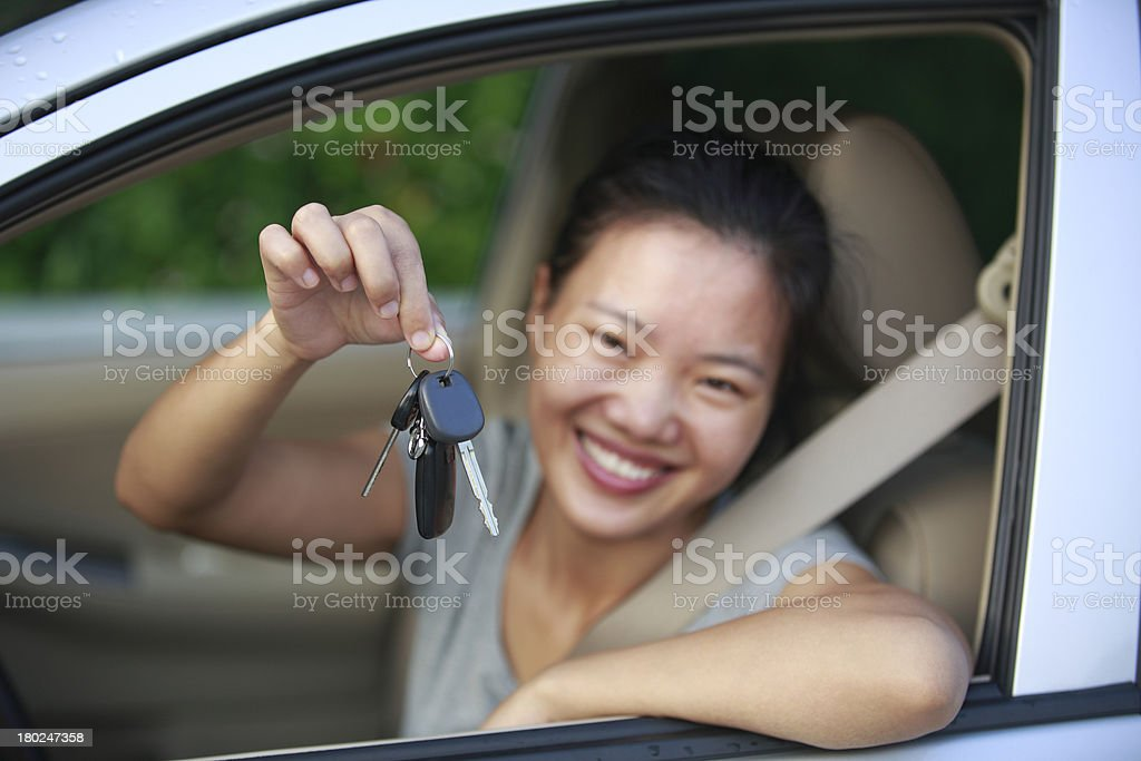 happy woman driver with her new car royalty-free stock photo