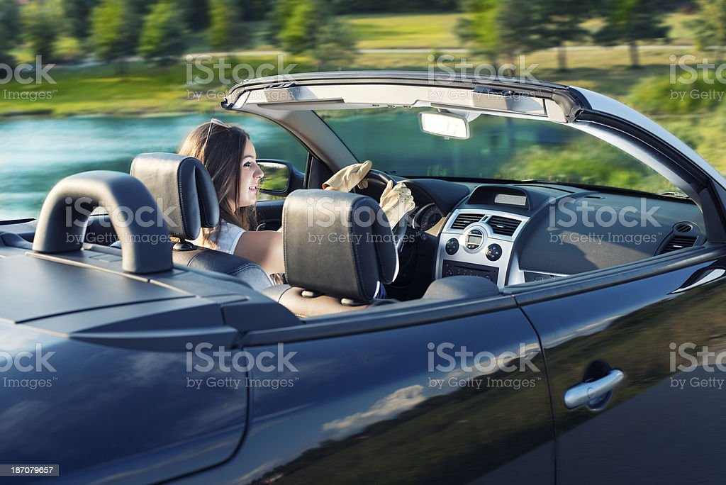 Happy woman driving a cabriolet car royalty-free stock photo