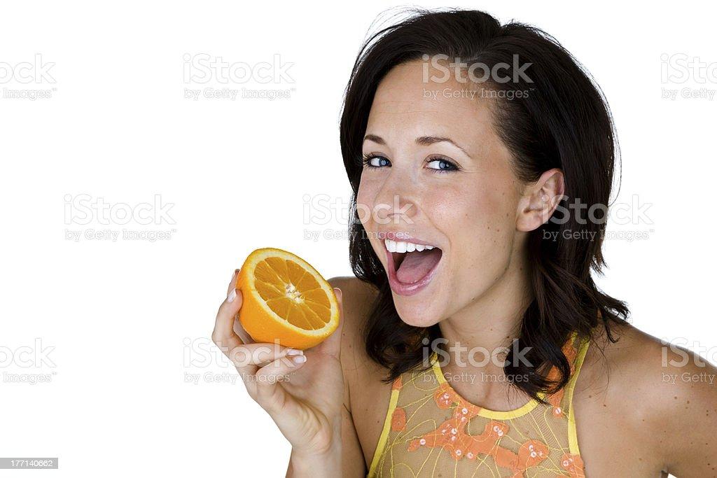 Happy woman eating an orange royalty-free stock photo