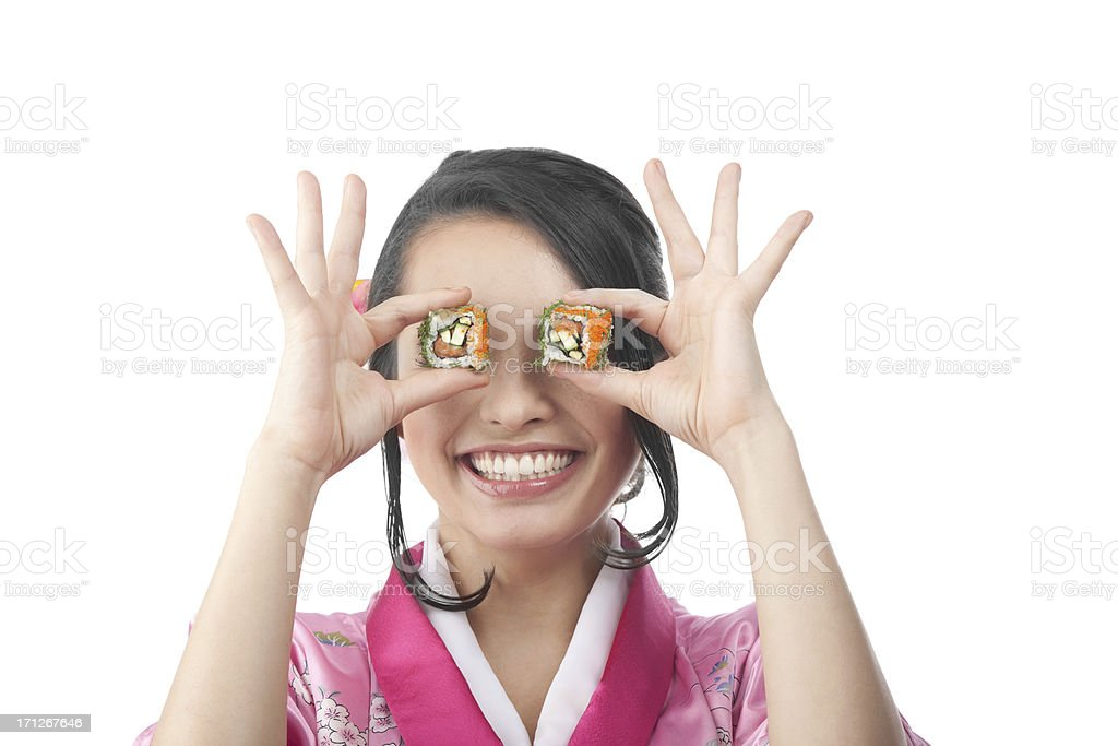 Happy Woman Eating Sushi with Chopsticks. royalty-free stock photo