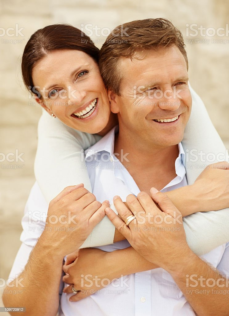 Happy woman embracing her husband royalty-free stock photo