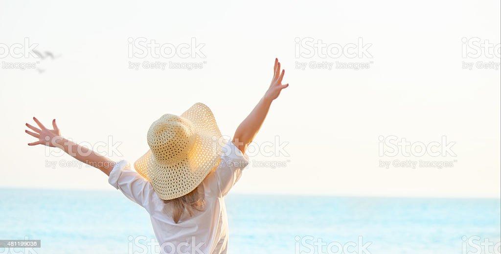 Happy woman  enjoy life on beach stock photo