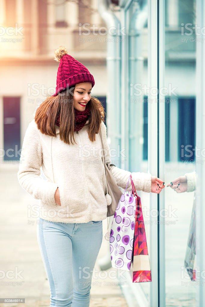 Happy woman enjoying shopping stock photo