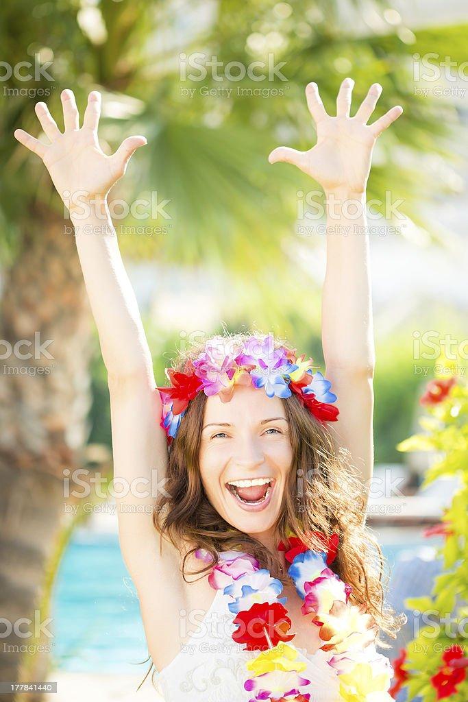Happy woman enjoying sun on the beach stock photo