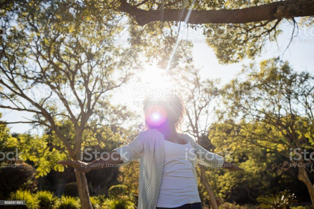 Happy woman enjoying sun stock photo