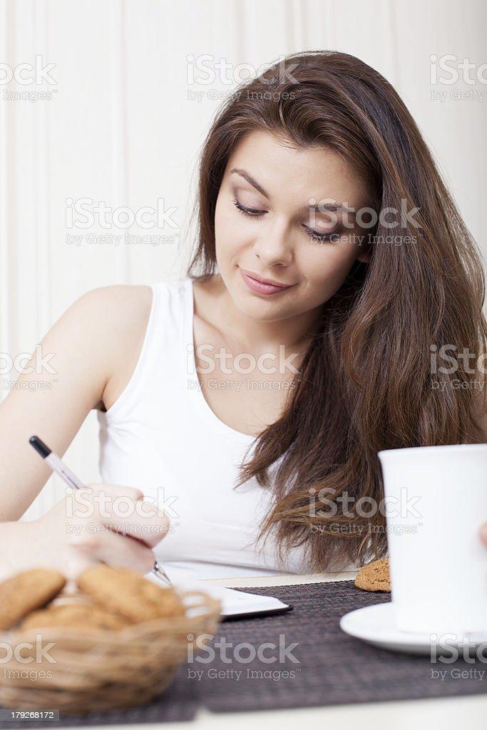 Happy woman enjoying tea and cookies royalty-free stock photo