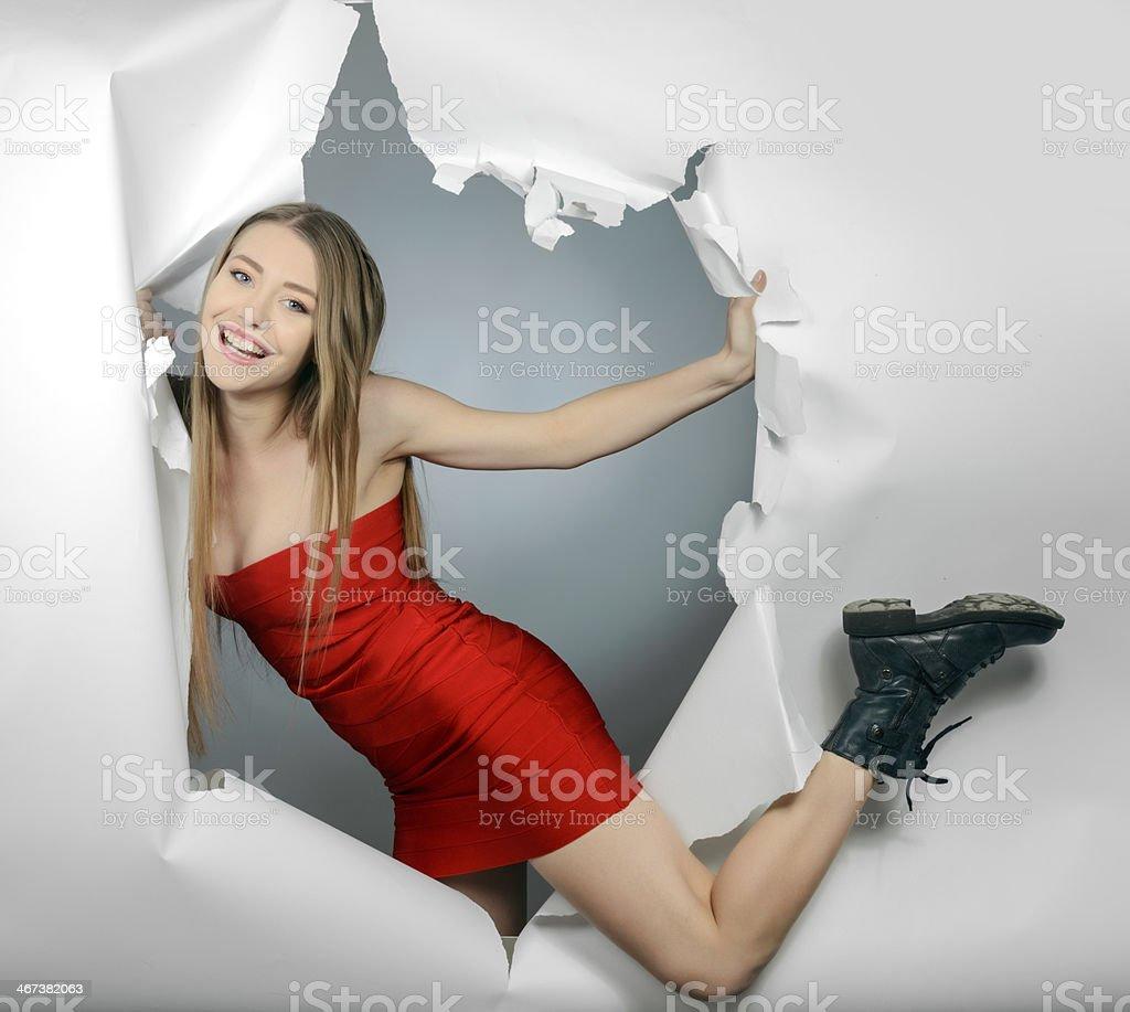 happy woman escape torn paper stock photo
