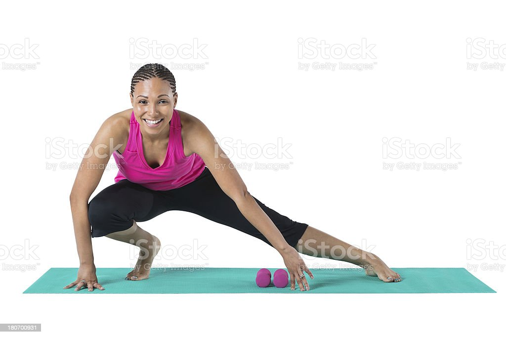 Happy woman exercising and stretching; studio shot royalty-free stock photo