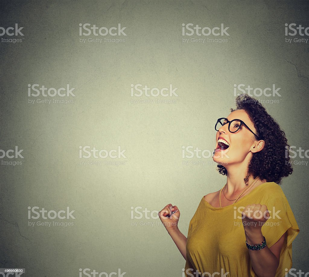 happy woman exults pumping fists ecstatic celebrates success stock photo