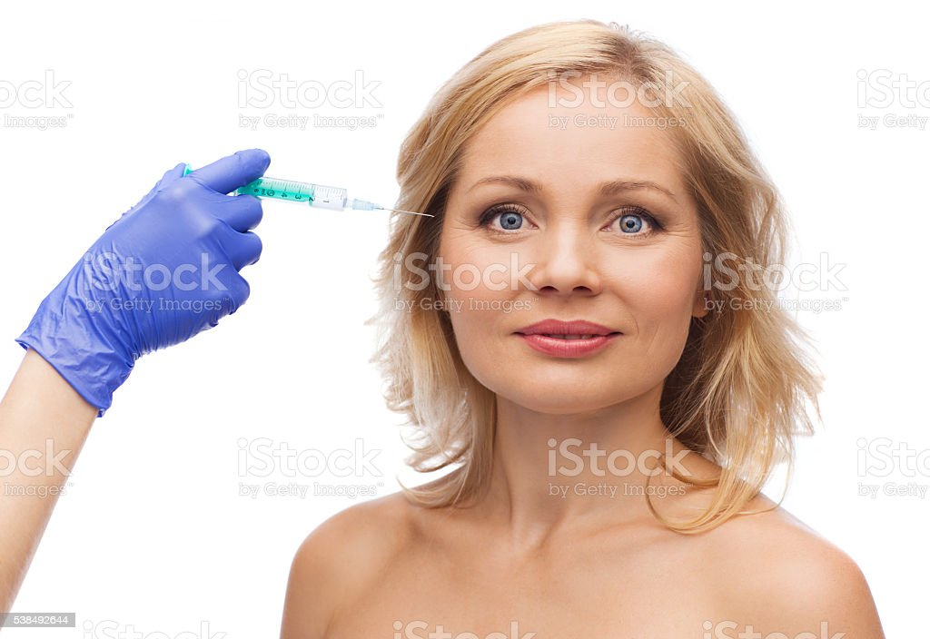 happy woman face and beautician hand with syringe stock photo