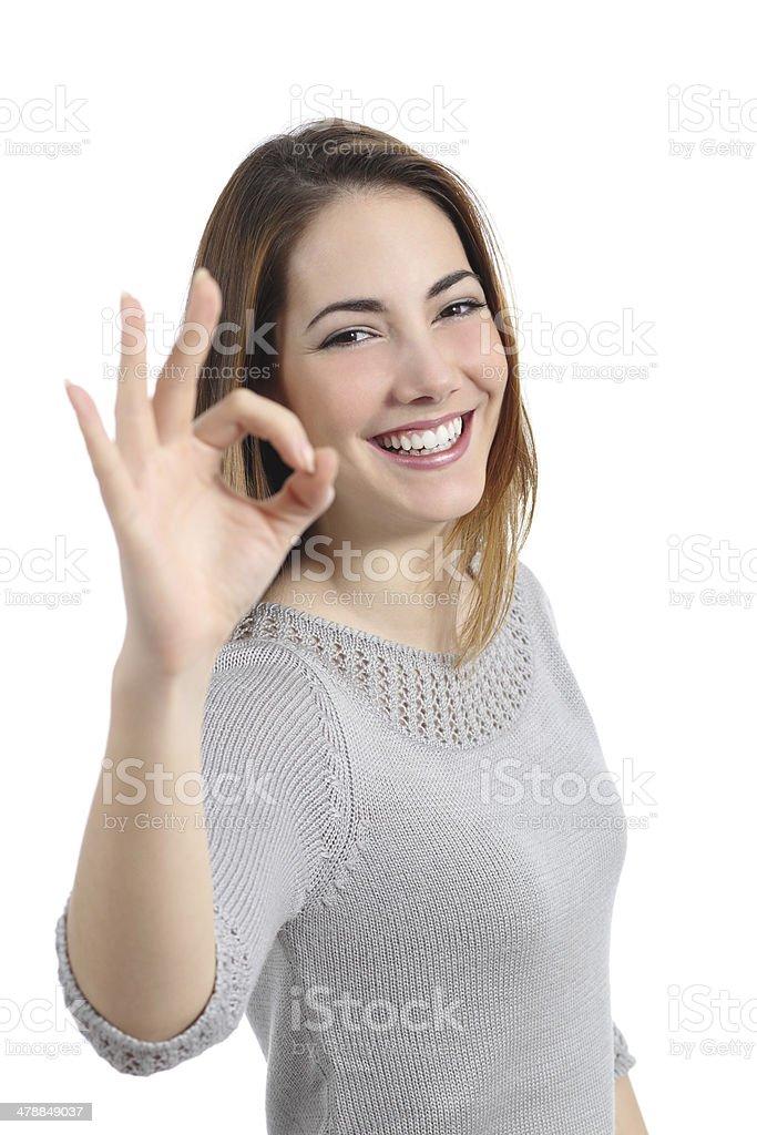 Happy woman gesturing ok stock photo