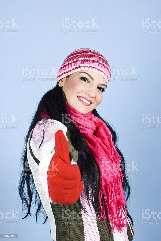 Happy woman giving thumbs up and smiling stock photo