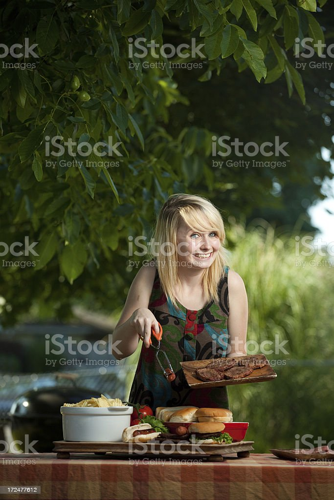 Happy woman grilling royalty-free stock photo