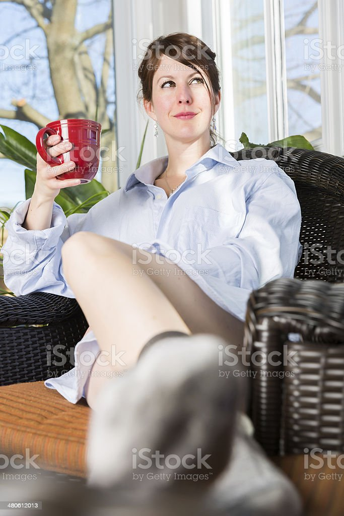 Happy Woman Having a Coffee in Sunroom royalty-free stock photo