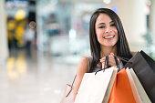 Happy woman having fun shopping