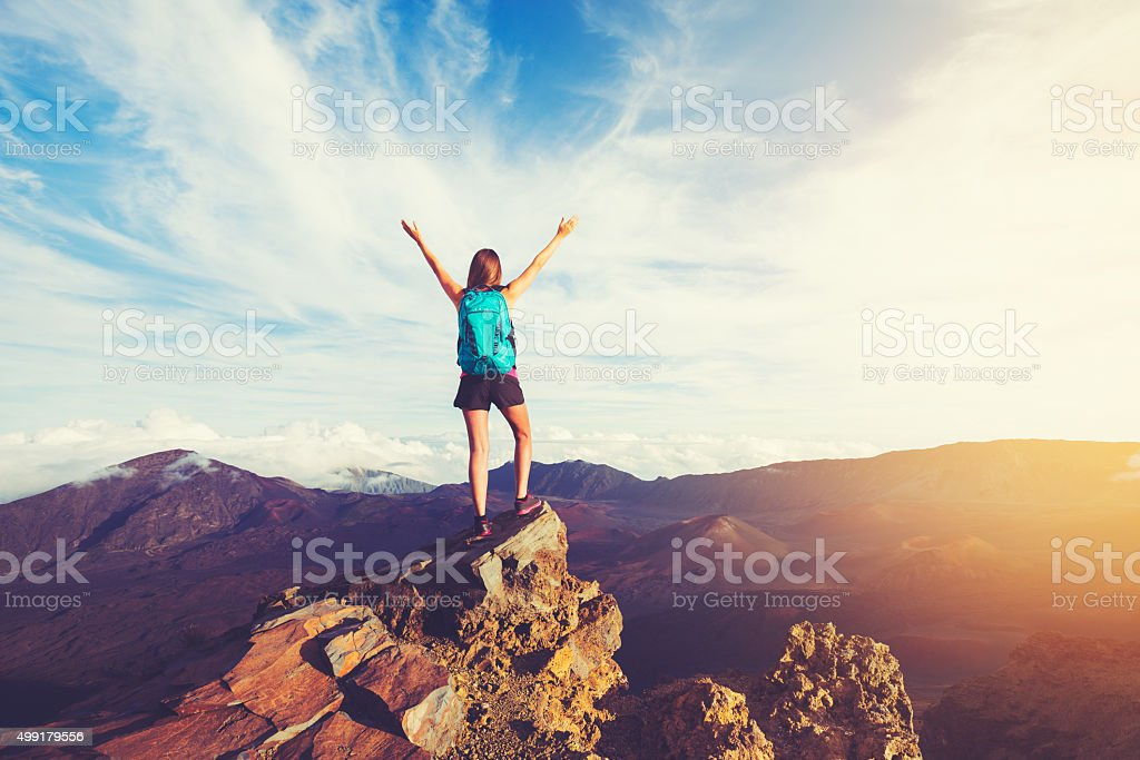 Happy Woman Hiker With Open Arms at Sunset stock photo